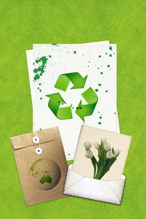 Ecology concept with recycling symbol on green grass texture photo