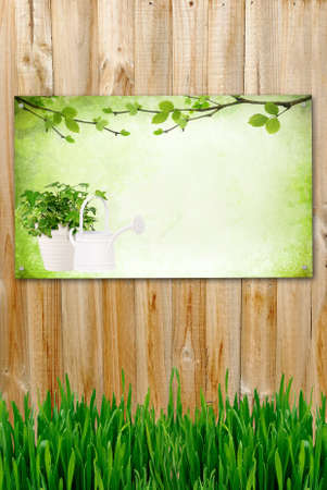 garden fence: Vertical wooden background with picture and green grass Stock Photo
