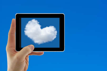 Cloud computing concept with human hand against blue sky photo