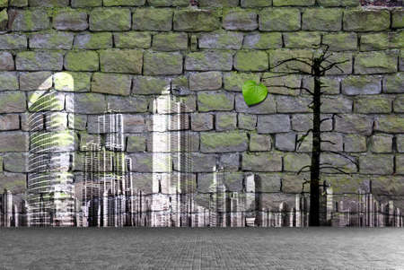 urban grunge: An image of city on a grunge wall background with a green leaf Stock Photo
