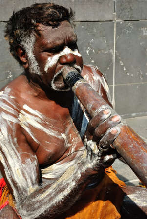 Aboriginal man performing for passing tourists, Australia, Melbourne