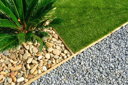 Landscaping combinations of grass, plant and stones