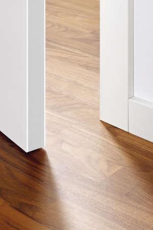 Empty room with wooden floor, door open Stock Photo - 22196413