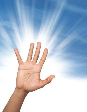 raises: Man hand raises high up over sunlight background