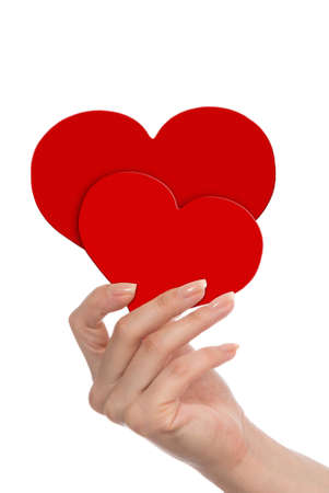Red hearts in woman's hand isolated on white, Valentines Day concept photo