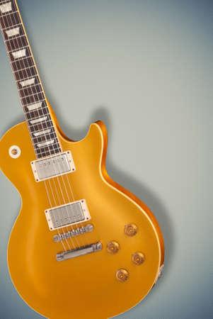 gold top: Vintage Gold top guitar over blue soft background