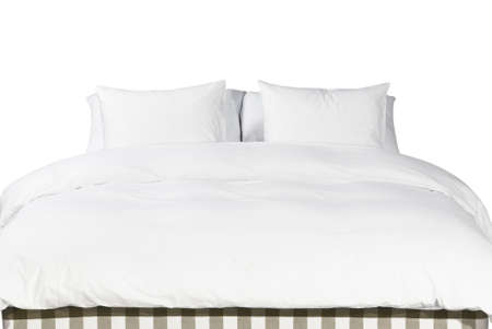bed linen: Comfortable soft white pillows and blanket on the bed Stock Photo