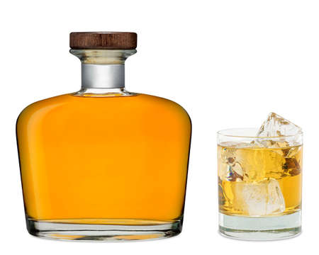 vintage bottle: Glass of whiskey with bottle on white background