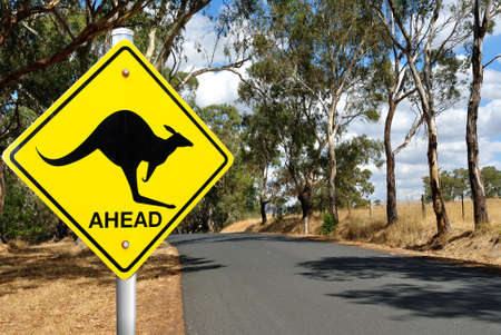 outback: Kangaroo warning sign on a road in the Australian outback