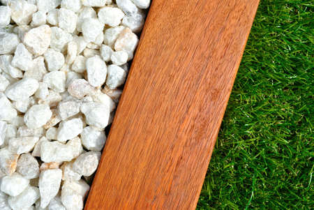 Landscaping combinations of grass, timber and stones