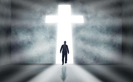 follow the leader: Man walking towards a huge cross passage Stock Photo