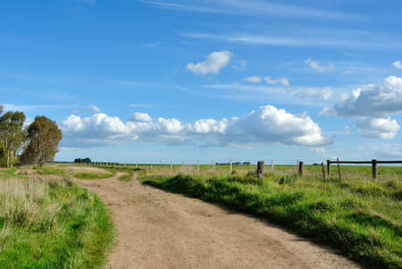 Dirt road in Australian countryside on spring sunny day photo