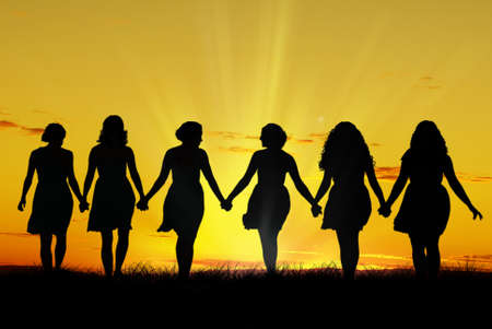 uniting: Silhouette of six young women, walking hand in hand