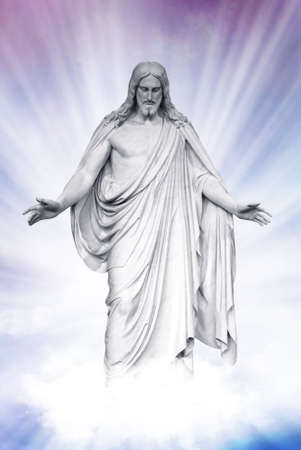 Statue of Jesus Christ on blue sky clouds background, Christianity concept photo