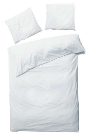 Close up of luxury blanket and pillows over white background