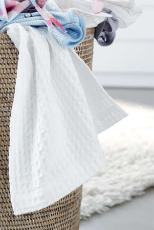 household chore: Overflowing laundry basket, household chore concept