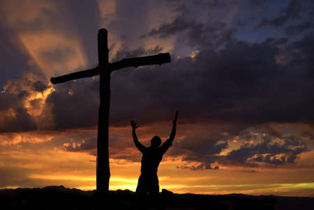Dramatic sky scenery with a mountain cross and a worshiper Imagens - 36072908