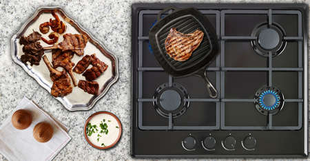 gas flame: Modern kitchen, delicious meat cooked on the hot plate Stock Photo