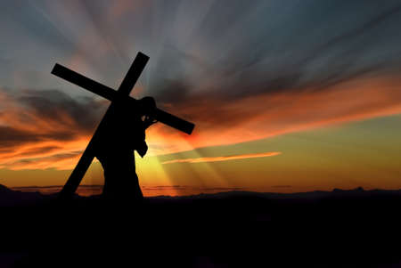 cross: Christ carrying cross up Calvary on Good Friday over dark and stormy sky