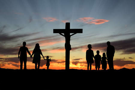 church group: Families walking toward the Cross over sunset background