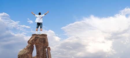 Man with arms raised in the sky, winner success concept Stock Photo