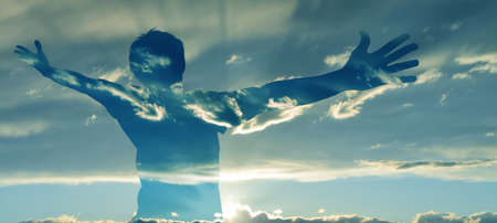 Double exposure image of man silhouette with wide open arms