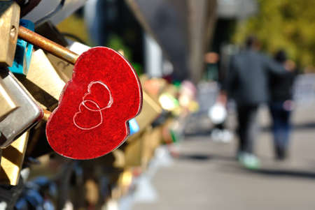 dedication: Red heart shaped lock on a bridge in Melbourne