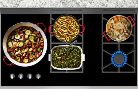gas fire: Cooking vegetables and meat on a gas stove top view Stock Photo