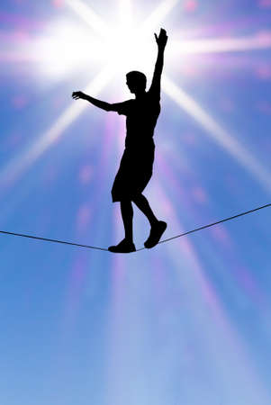 Man balancing on the rope concept of risk taking and challenge Stock Photo - 46326025