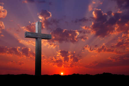 cross: Old wooden cross over red and purple sunrise or sunset
