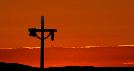 easter morning: Clouds and sunbeams shining on a cross for Easter morning Stock Photo