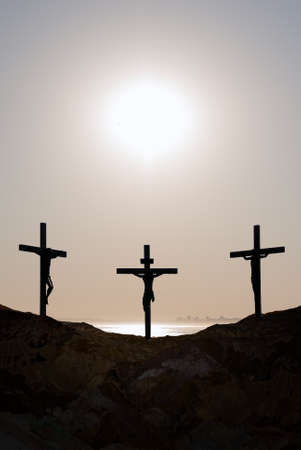 Three crosses on the mountain Golgotha representing the day of Christ's crucifixion 스톡 콘텐츠