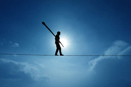 Tightrope walker balancing on the rope concept of risk taking and challenge