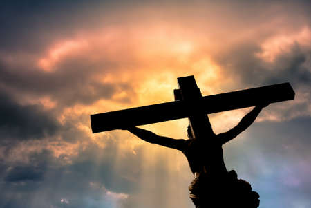 resurrected: Jesus Christ Son of God over dramatic sky background religion and spirituality concept Stock Photo