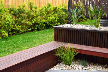 Combinations of plants, timber wall, decking benches and rocks