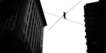 tightrope: Highline walker balancing on the rope concept of risk taking and challenge Stock Photo