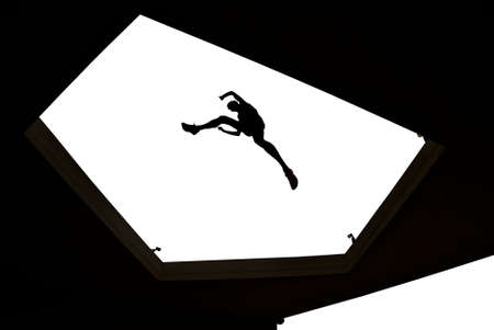 risk taking: Man jumping from roof to roof concept of risk taking and challenge Stock Photo