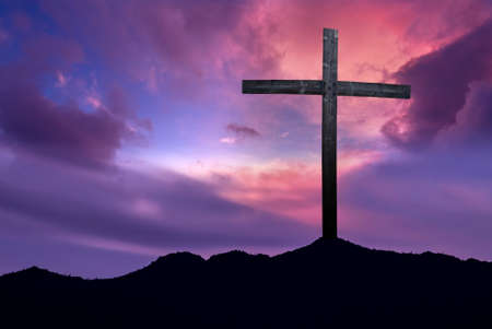 Silhouette of Christian cross at sunrise or sunset concept of religion Stock Photo