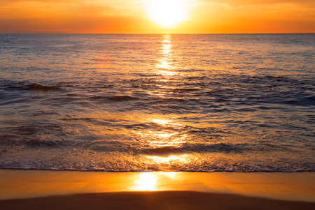 sunrise ocean: Sunset or sunrise colors over the ocean or sea