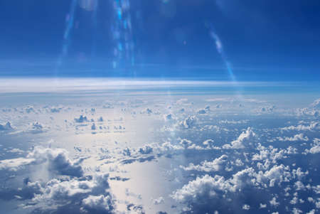rise to the top: Aerial view of blue sky and clouds