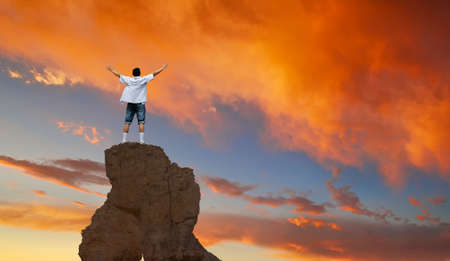 winner man: Man with arms raised in the sky winner success concept