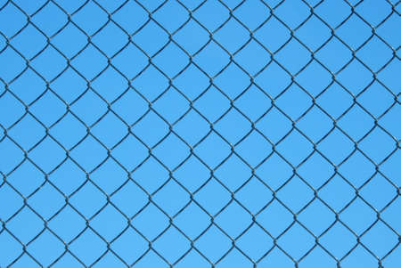 wire mesh: Wire mesh steel with blue sky background Stock Photo