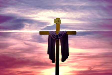 Silhouette of Christian cross at sunrise or sunset panoramic view