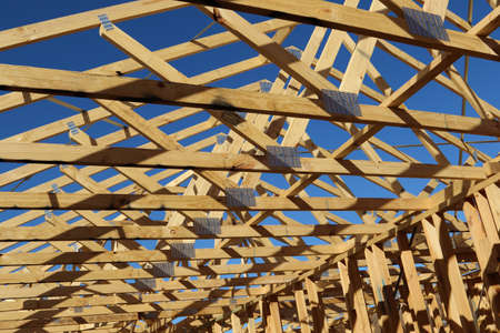 roof framing: New residential construction home framing with roof view