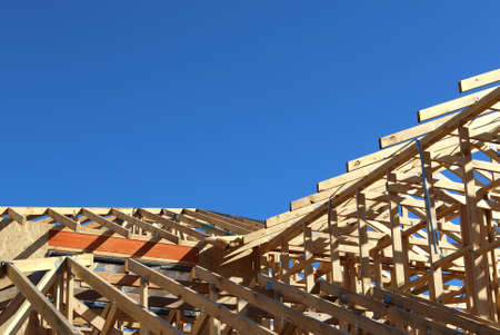 timber frame: New residential construction home framing with roof view