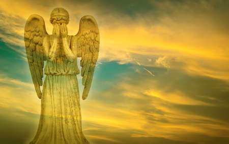 weeping angel: Weeping angel over bright sky background