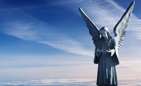 catholic angel: Sculpture of beautiful angel over magnificent sky