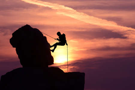 intrinsic: Silhouette of a climber over beautiful sunset