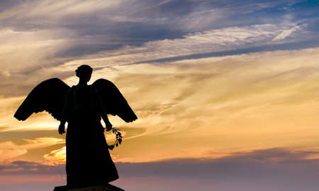 weeping angel: Angel Silhouette over bright sky background Stock Photo