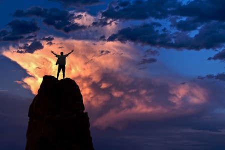 winner man: Winner man standing on the top of mountain over dramatic sky